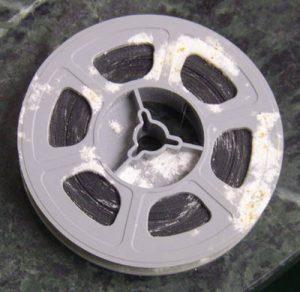 Mold accumulation on 8mm film reel